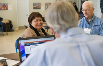 photo of AARP tax aide giving assistance to clients