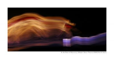 At the Point of Discovery. Photo by David Jouris, 2014. Blurred dancer across dark stage.