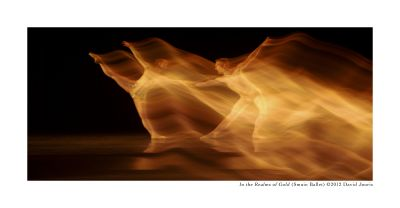 At the Point of Discovery. Photo by David Jouris, 2014. Gold blurred dancer across dark stage.