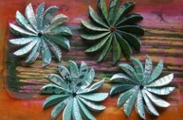 photo of four green paper flowers; used by permission of Nga Trinh