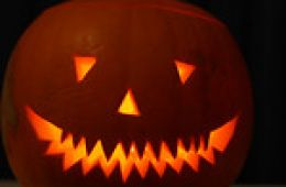 photo of a carved jack o'lantern pumpkin with a glowing light coming from within