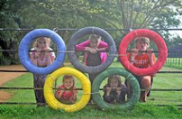 photo of kids in Olympic circle logo; Olympic Kids by Vincent Angler is licensed under CC BY 2.0
