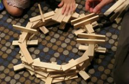 "photo of KEVA planks being made into a structure; ""Work in Progress"" by Ruth Hartnap is licensed under CC BY 2.0"