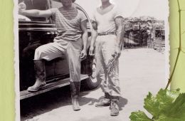 book cover with two men, farmworkers, standing by a car