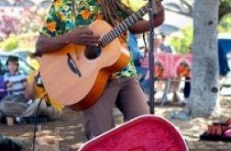 photo of Asheba playing guitar