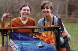 photo of musicians Anna and Elizabeth with their instruments and artwork