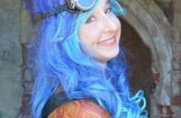 photo of author Ilona Bray with blue hair as Mossby's Magicalist Assistant