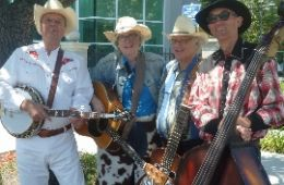 photo of the four members of the Prairie Rose Band with their instruments