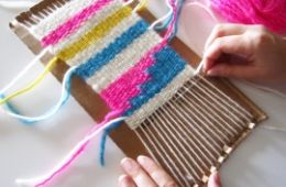 photo of person weaving on a cardboard loom; used by permission of Amelia Shrader, GoGo Craft