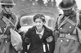 Pictured here Grandma Tsyu escorted by armed men to a camp (1942)