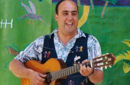 photo of Juan Sanchez playing guitar