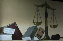 painting of law books and scales of justice photo courtesy of Flickr user Clyde Robinson