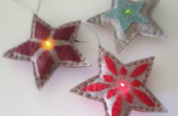 Three star-shaped light-up ornaments
