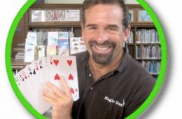 photo of magician Dan Sneider holding cards