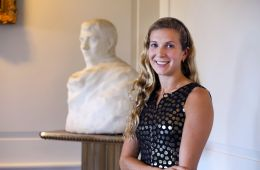 Mallory Mortillaro standing in front of Rodin sculpture