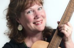 close up photo of Marylee Sunseri and guitar