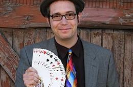 photo of magician Mike Della Penna with card trick