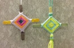 photo of two Ojo de Dios, made with yarn and popsicle sticks