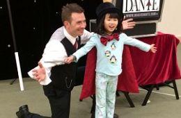 photo of magican Dante Mancini with girl wearing magician hat