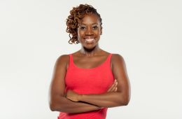 photo of dancer Quynn Johnson smiling with arms folded