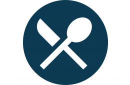 dark blue circle with a silhouette of a white spoon and fork crossed in an x
