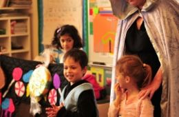 photo of kids and teaching artist performing Hansel and Gretel with Sing a Story program