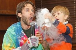 photo of presenter with child doing science experiment