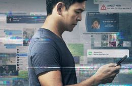 Movie poster with main character looking at cellphone.
