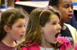 photo of three kids singing during SF Opera Guild's Sing a Story program