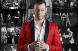 color photo of magician Spencer Grey standing in front of a collection of black and white images of his shows
