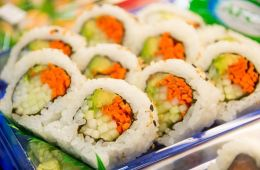 Sushi rolls with avocado, carrots, and cucumbers.
