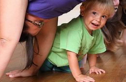 "photo of child under mother doing downward dog; ""Oct 6 (2)"" by Jessica Lucia is licensed under CC BY-NC 2.0  - on Flickr"