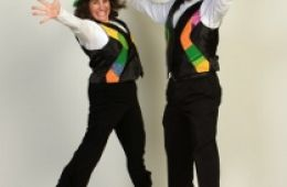 photo of musicians Jenny and David Heitler-Klevans jumping