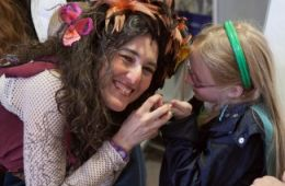 photo of Rosy the Tree Faerie (Magician Erica Sodos) and young fan; photo by Wild Earth