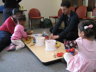 photo of kids at art station at Family Place Parent-Child Playshop
