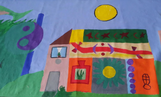 Detail of the banner including a taijitsu (yin/yang symbol), and brightly colored building under a yellow sun