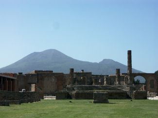 photo of Pompeii's Temple of Jupiter with Mt. Vesuvius in the background