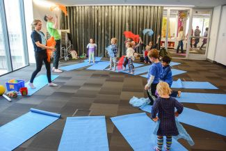 photo of children and adults doing yoga