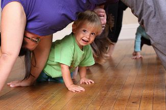 "photo of child under mother doing downward dog; image ""Oct 6 (2) by Jessica Lucia is licensed under CC BY-NC 2.0  - on Flickr"
