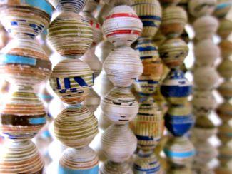 Strings of handmade paper beads - image courtesy of Flickr user Brad Flickinger
