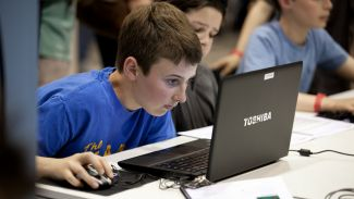 photo of boy looking intensely at computer screen