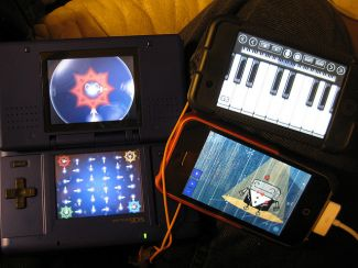 Handheld devices playing music - Image attributed to rorowe8 (http://www.flickr.com/photos/rorowe/) CC BY-NC-ND 2.0