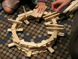 """photo of KEVA planks being made into a structure; """"Work in Progress"""" by Ruth Hartnap is licensed under CC BY 2.0"""