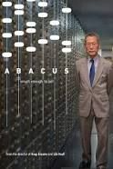 Mr. Sung, owner of Abacus Federal Savings pictured standing by a vault