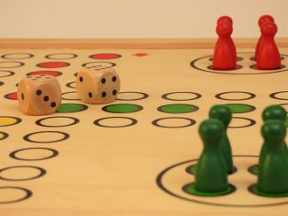 Parcheesi board and pieces.