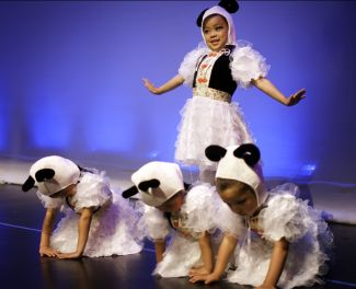 photo of young dancers dressed as pandas