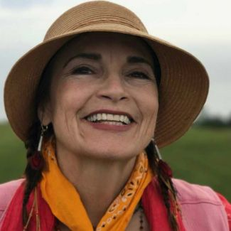 photo of storyteller Alicia Retes wearing a hat and smiling