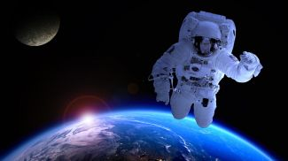 Astronaut floating over Earth with moon in background.