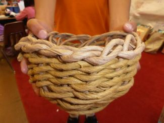photo of a child holding a basket they made