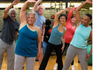 six people, smiling, dancing, and stretching